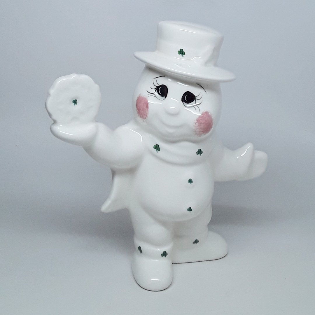 Dona Snowman with Shamrocks in Balancing a Snowflake Pose